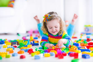 Girl playing Lego